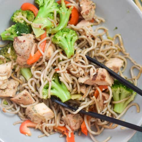 Final dish of stir fry egg noodles with chicken and veggies on serving bowl | Bucket List Tummy