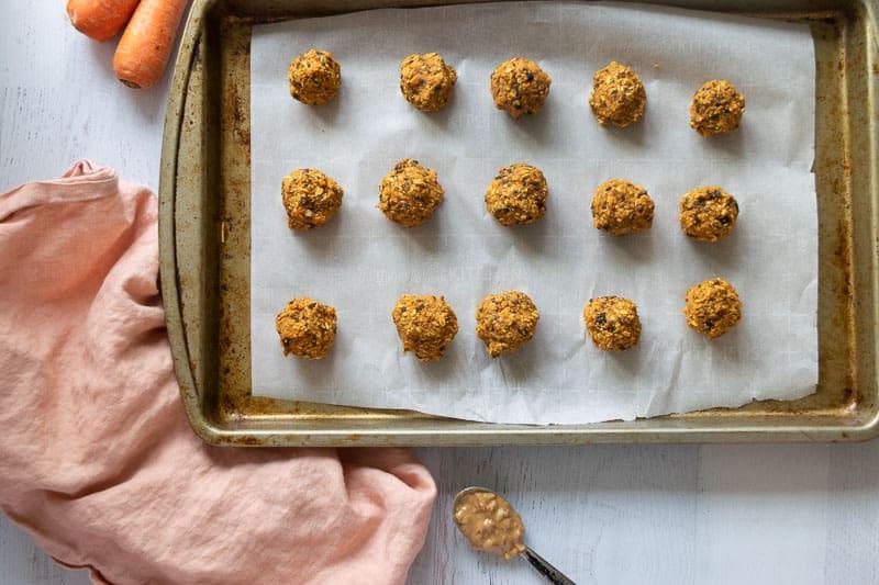 carrot oat energy bites on baking sheet | Bucket List Tummy