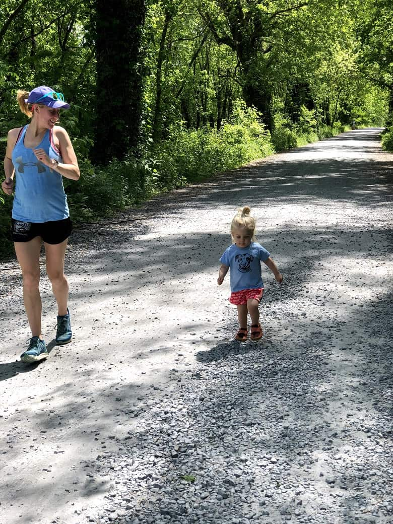pregnant mom running with toddler