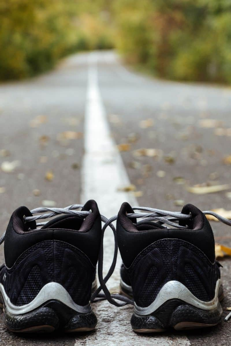 black running shoes with road ahead | Bucket List Tummy