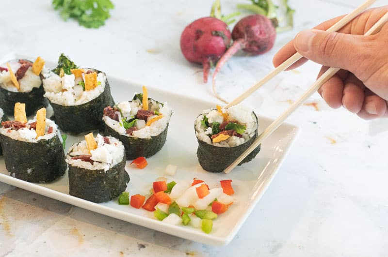 beef sushi on plate with chopsticks