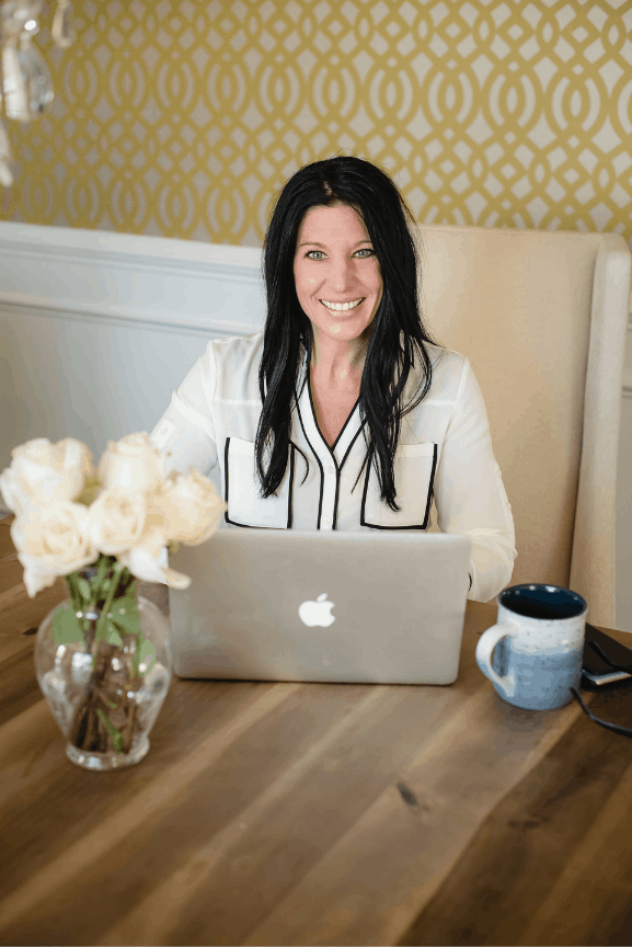 Heather Mangieri sitting behind computer