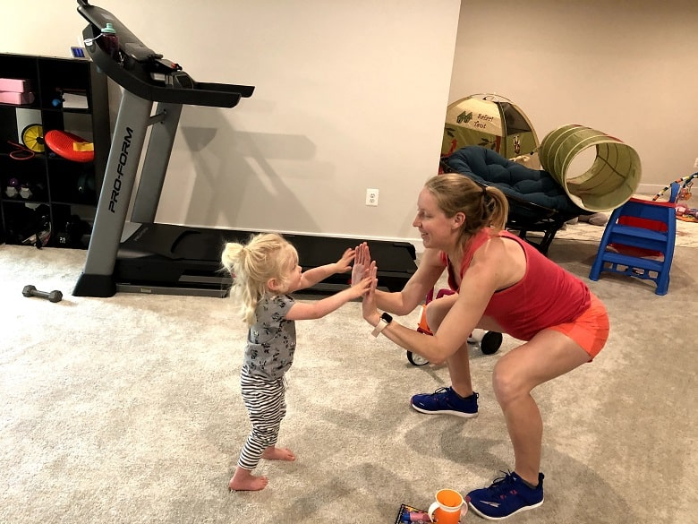 mom and daughter high fiving during workout