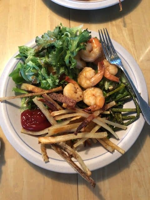 shrimp with fries and salad