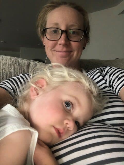 toddler laying on mommy's belly