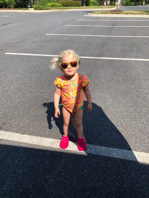 toddler in sunglasses and bathingsuit