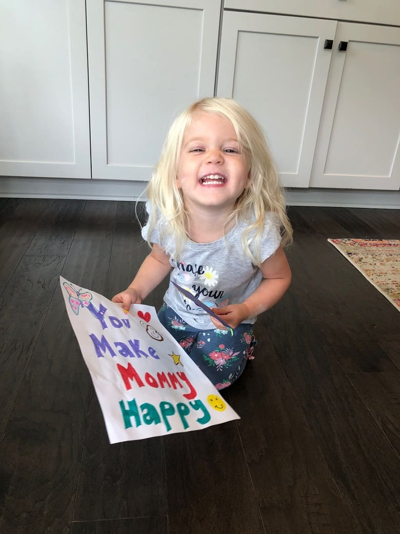 daughter holding handmade sign up