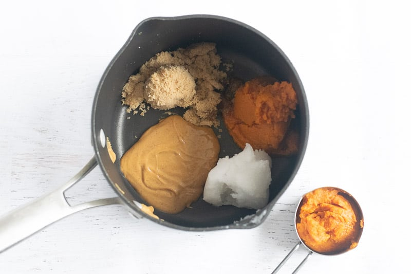 pot with brown sugar, pumpkin puree, coconut oil and peanut butter