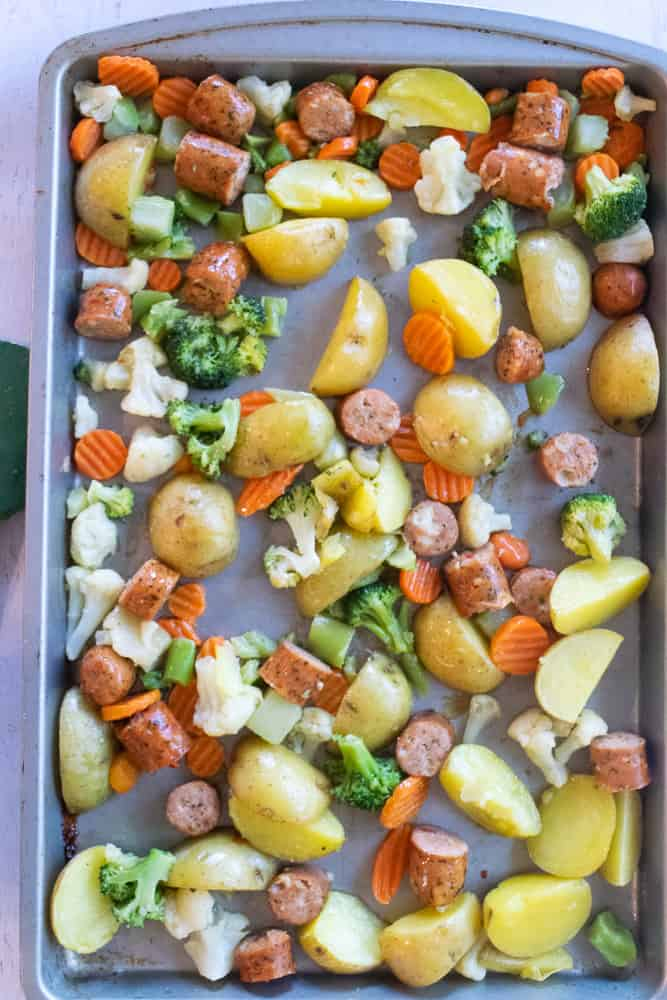 overhead view of sheet pan chicken with potatoes and vegetables