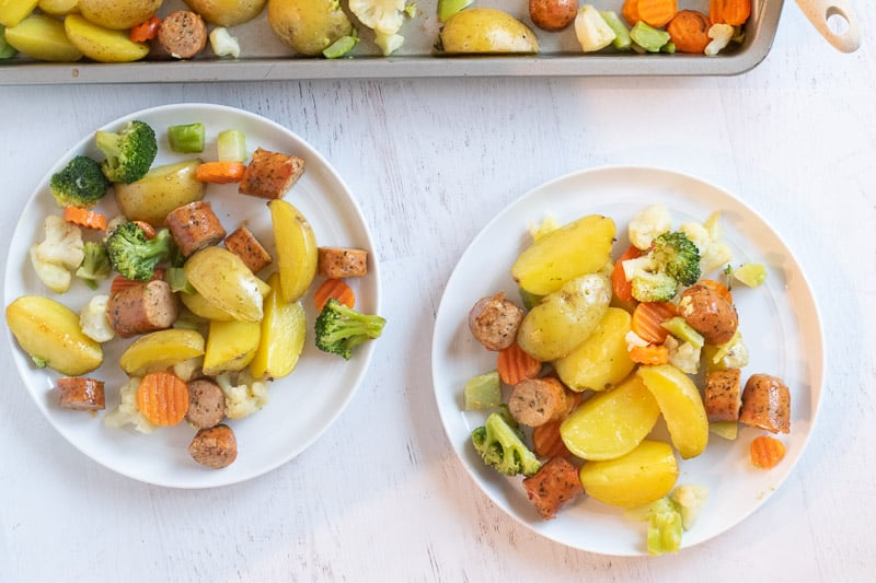 chicken sausage, potatoes and veggies on white plates