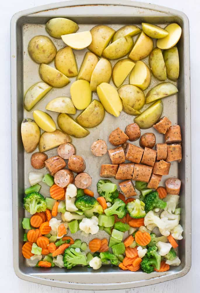 potatoes, chicken sausage and veggies on a sheet pan