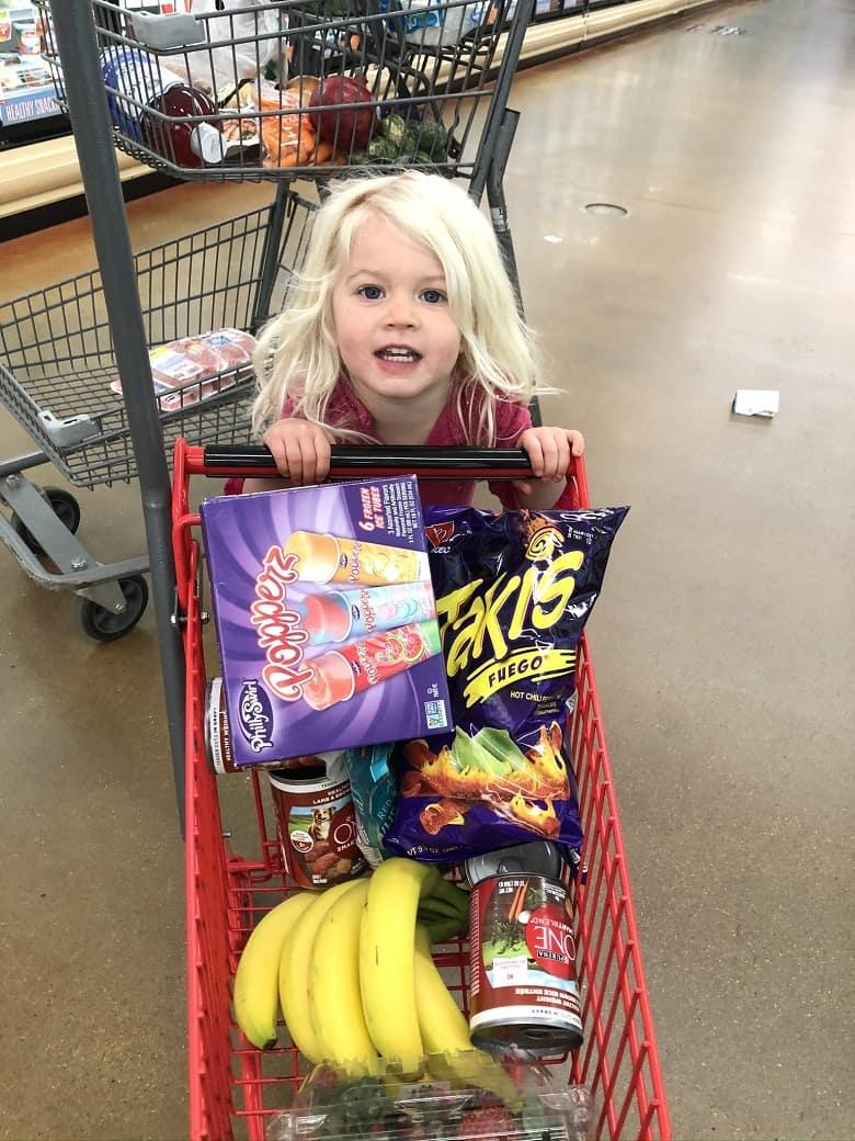 toddler pushing grocery cart