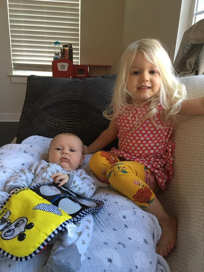 baby on boppy and big sister