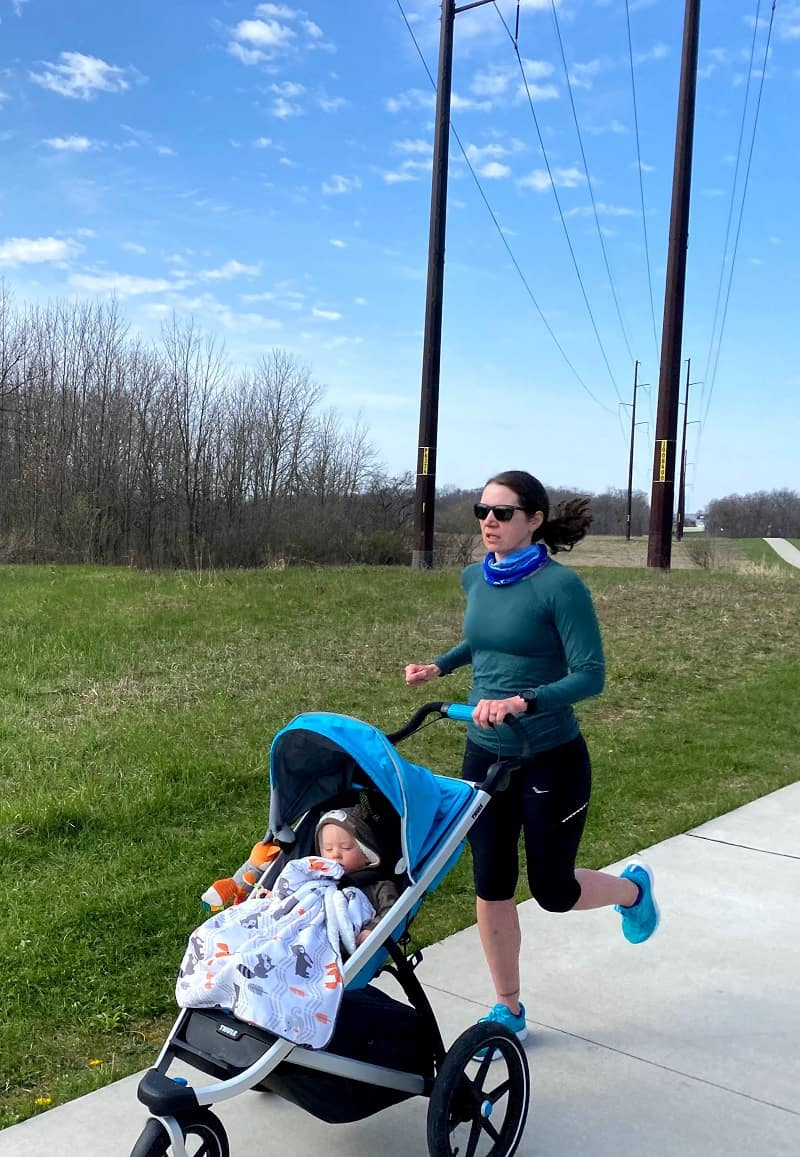 mom running and pushing stroller with baby in it