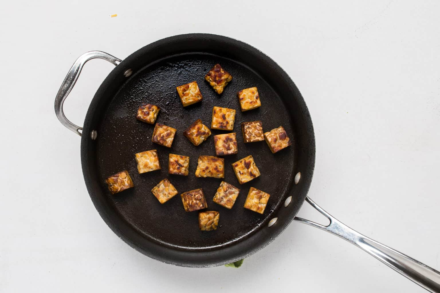 skillet with roasted and cubed tempeh