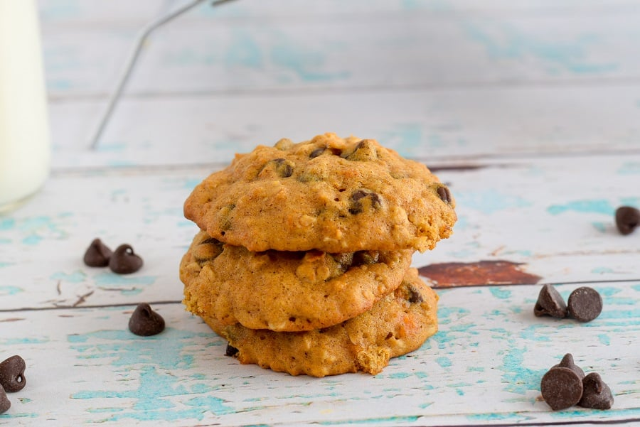 stack of sweet potato breakfast cookies with chocolate chips on blue wooden board