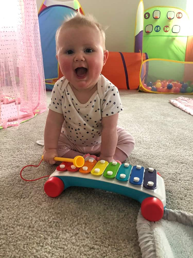 6 month old sitting up with xylophone