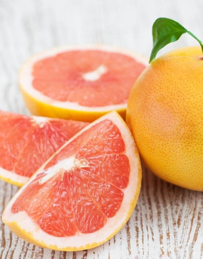 grapefruit next to sliced grapefruit