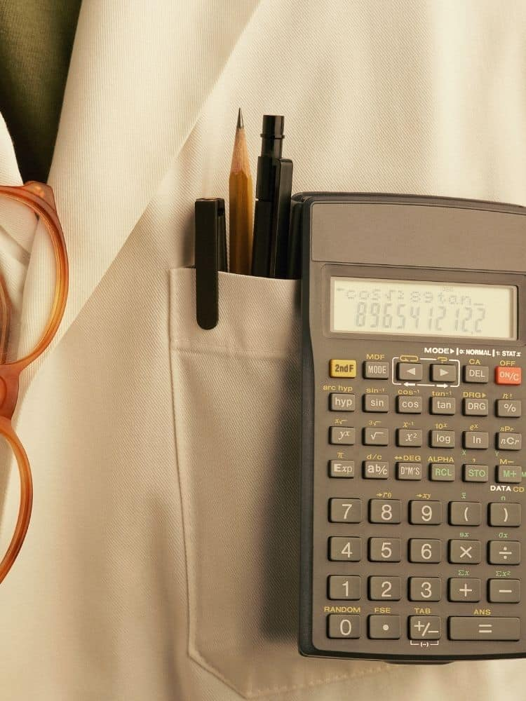 white lab coat with glasses, pens and a calculator in pocket
