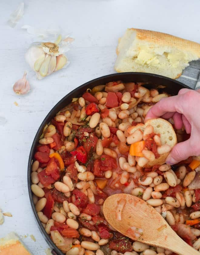 skillet with cannellini beans, tomatoes and herbs