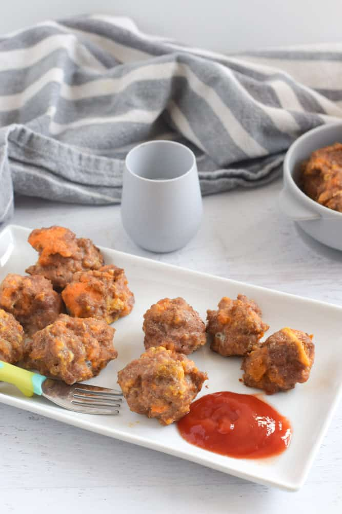 ground turkey meatballs for baby led weaning on white plate