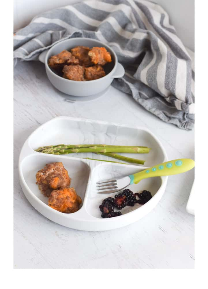 Turkey meatballs with blackberries and asparagus on toddler friendly plate