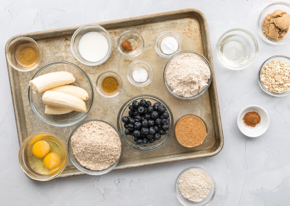 ingredients on baking sheet for gluten free blueberry muffins
