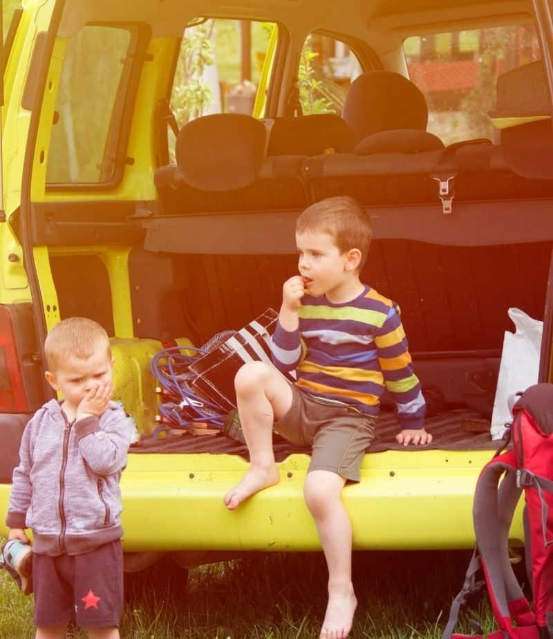 two kids in a van with good road trip food