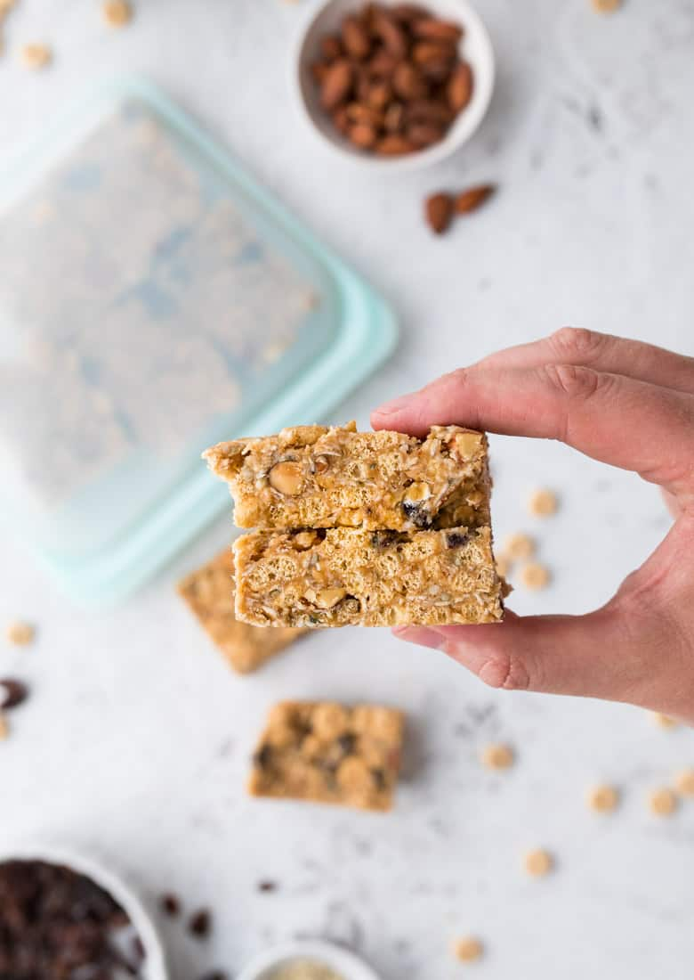 holding healthy cereal bars with peanut butter and cheerios and nuts