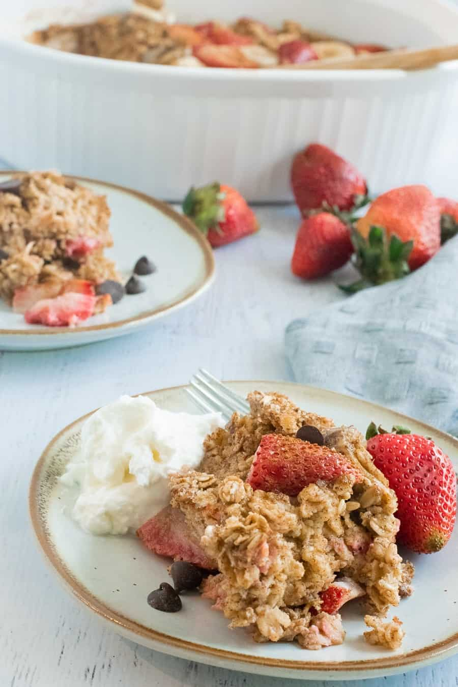 plate of baked oatmeal with strawberries and yogurt