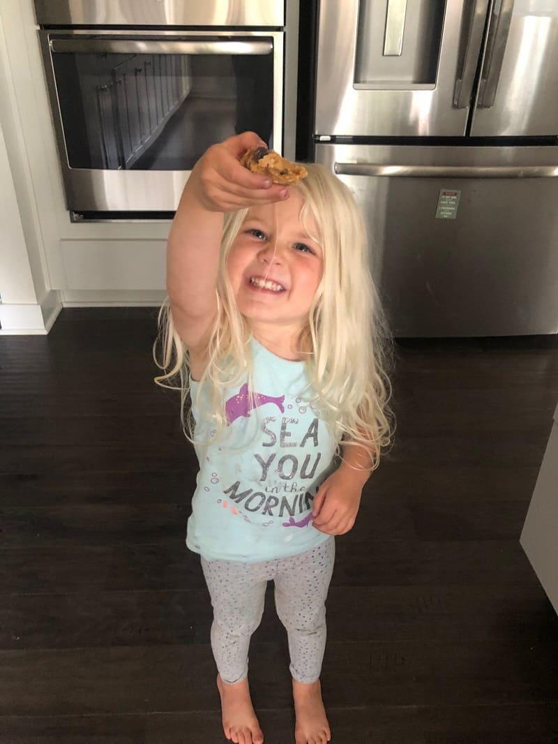 toddler holding frozen cookie dough bite