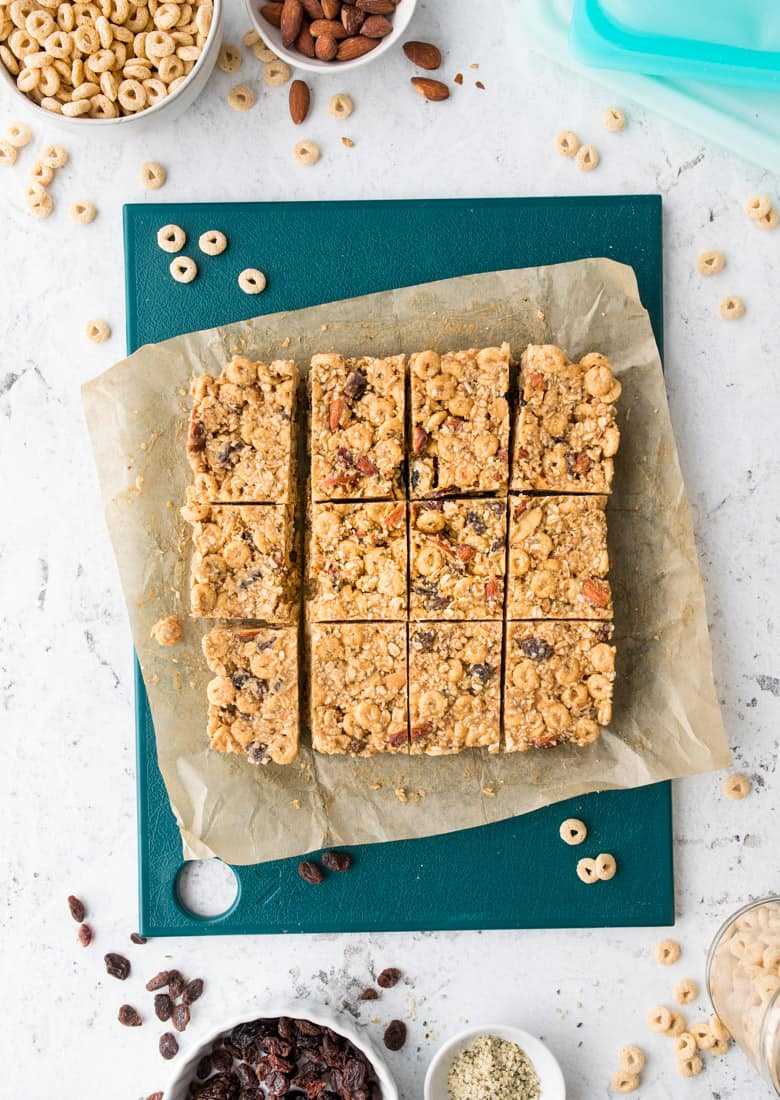 overhead shot of trail mix bars on parchment paper and counter top