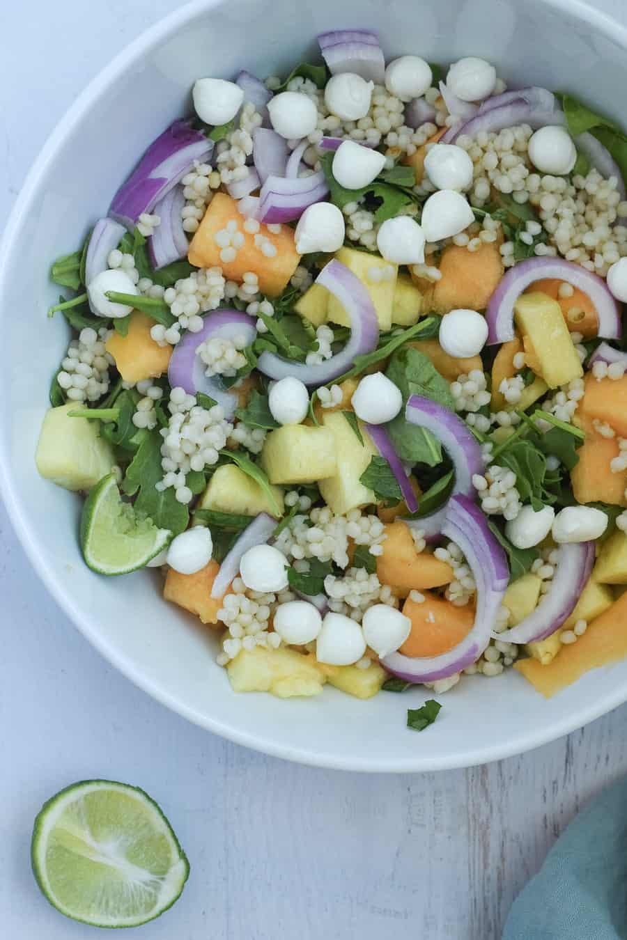 Pineapple salad recipe with mozzaralla, red onion and cous cous