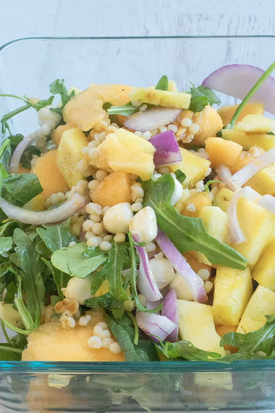 store mint cantaloupe salad in a glass tupperware container