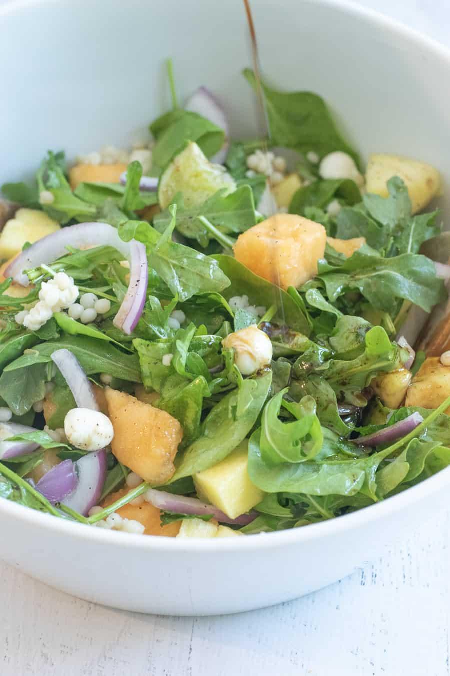 honey balsamic dressing over pineapple mint salad