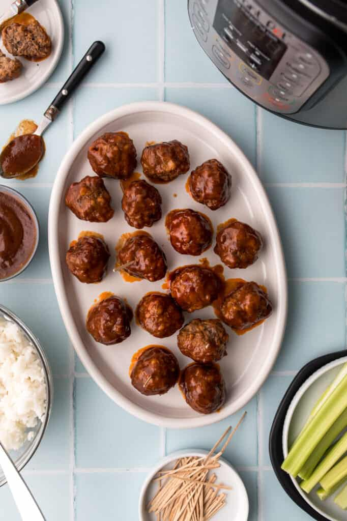 Bison meatballs in BBQ sauce on white plate