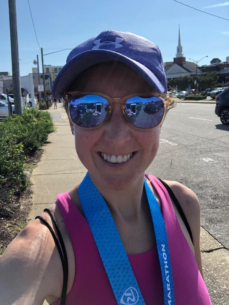 wearing half marathon medal from rnr Virginia Beach
