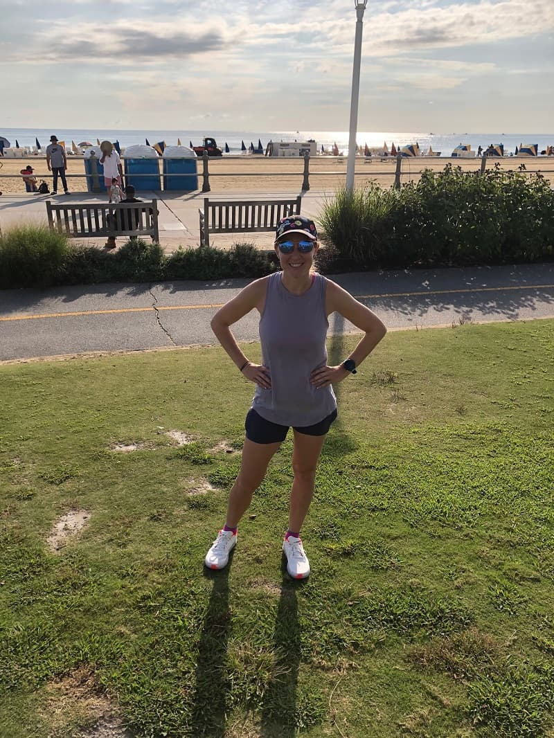 standing in front of boardwalk in virginia beach