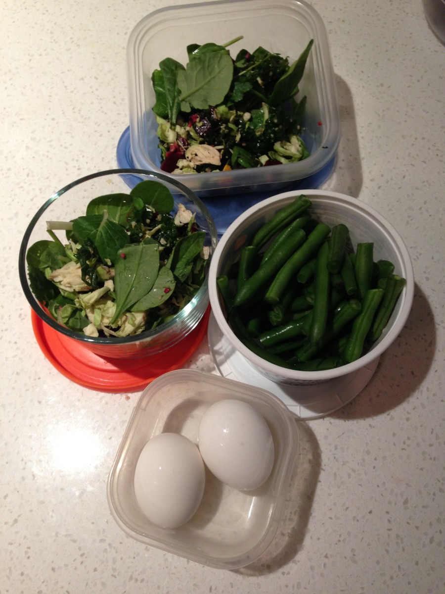 side salads with spinach, beets and kale, cut green beans and hard boiled eggs
